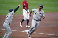 FILE - In this Sept. 1, 2020, file photo, Chicago White Sox's Jose Abreu, right, gets the go-ahead as he rounds third base to score on a two-run double by Eloy Jimenez off Minnesota Twins pitcher Michael Pineda during the first inning of a baseball game in Minneapolis. Abreu won the AL MVP prize Thursday, Nov. 12, a reward for powering his team back into the playoffs for the first time since 2008. (AP Photo/Jim Mone, File)