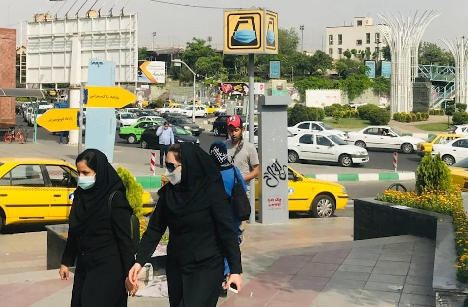 People wearing face masks as preventive measure against the coronavirus (COVID-19), walk at a street as daily life continues in the country amid COVID-19 pandemic in Tehran, Iran, on April 27, 2021. (Muhammet Kursun/Anadolu Agency via Getty Images)