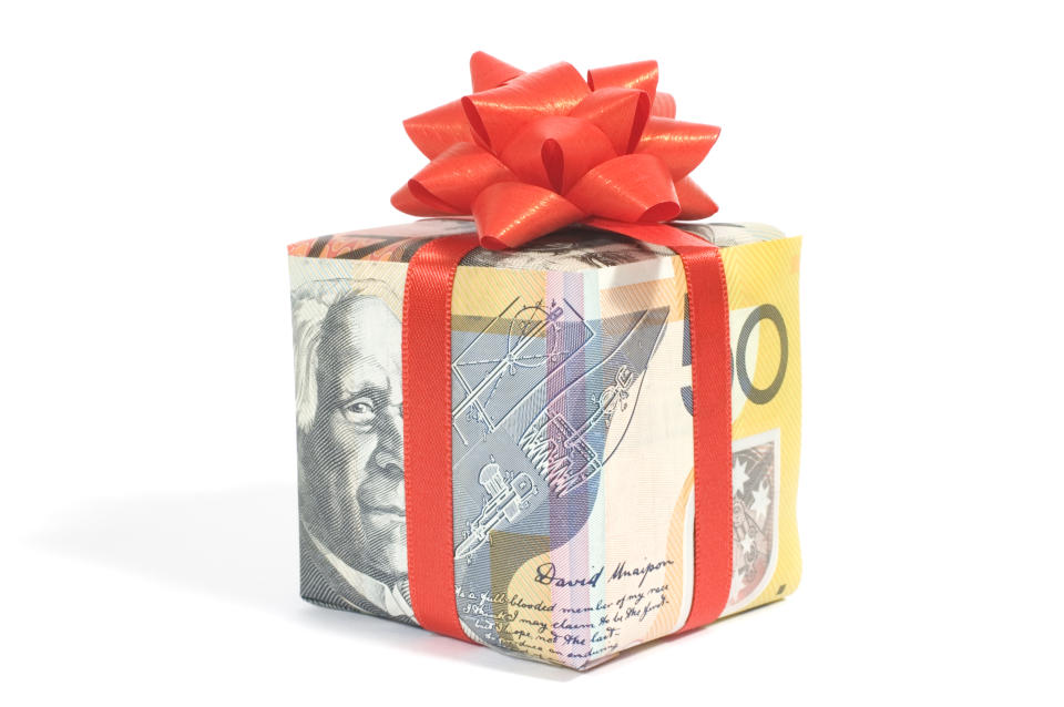 gift box made of Australian banknotes with red ribbon and bow
