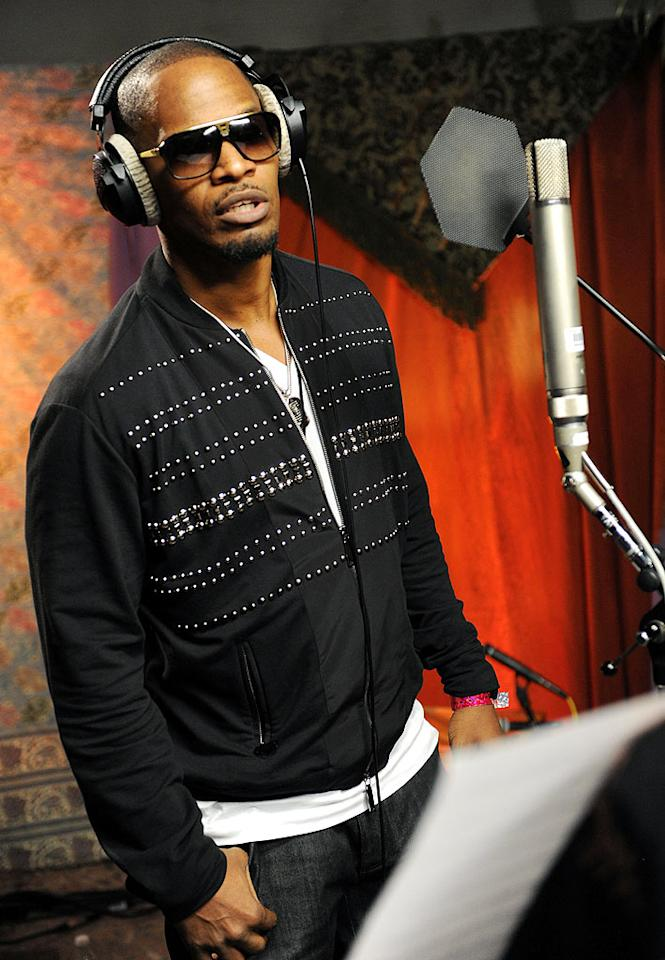 "Jamie Foxx focused while performing his solo vocals. According to reports, a few of the song's lyrics have been updated. Kevin Mazur/<a href=""http://www.wireimage.com"" target=""new"">WireImage.com</a> - February 1, 2010"
