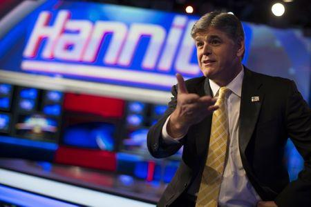 "FILE PHOTO: Fox News Channel anchor Sean Hannity poses for photographs as he sits on the set of his show ""Hannity"" at the Fox News Channel's studios in New York City, October 28, 2014.  REUTERS/Mike Segar"