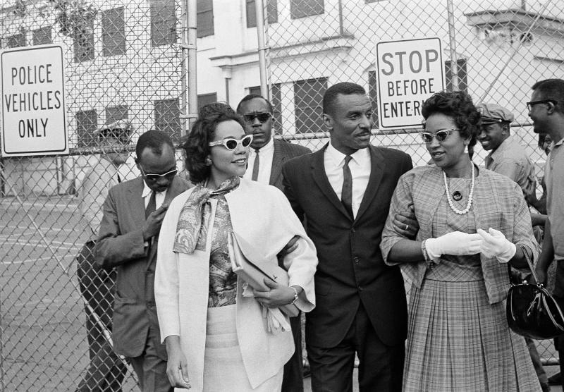 FILE - In this April 18, 1963 file photo, Coretta Scott King Jr., left,  the Rev. Fred L. Shuttlesworth, center, and Mrs. Juanita Abernathy, leave Birmingham jail after visiting Rev. Martin Luther King, Jr. and Rev. Dr. Ralph Abernathy in Birmingham, Ala. Juanita Abernathy, who wrote the business plan for the 1955 Montgomery Bus Boycott and took other influential steps in helping to build the American civil rights movement, has died. She was 88. Family spokesman James Peterson confirmed Abernathy died Thursday, Sept. 12, 2019 at Piedmont Hospital in Atlanta following complications from a stroke.(AP Photo/File)