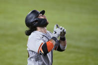 San Francisco Giants' Brandon Crawford gestures skyward as he approaches the plate after hitting a three-run home run off Texas Rangers reliever Taylor Hearn during the ninth inning of a baseball game in Arlington, Texas, Tuesday, June 8, 2021. (AP Photo/Tony Gutierrez)