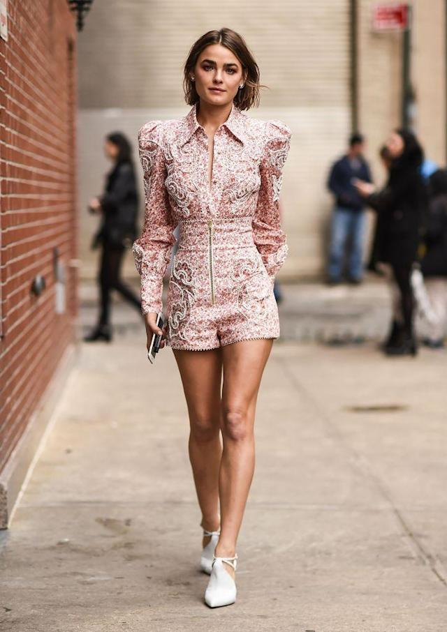 <p>The model seemed unbothered by the low temperature as she strutted with bare legs. (Photo: Getty Images) </p>