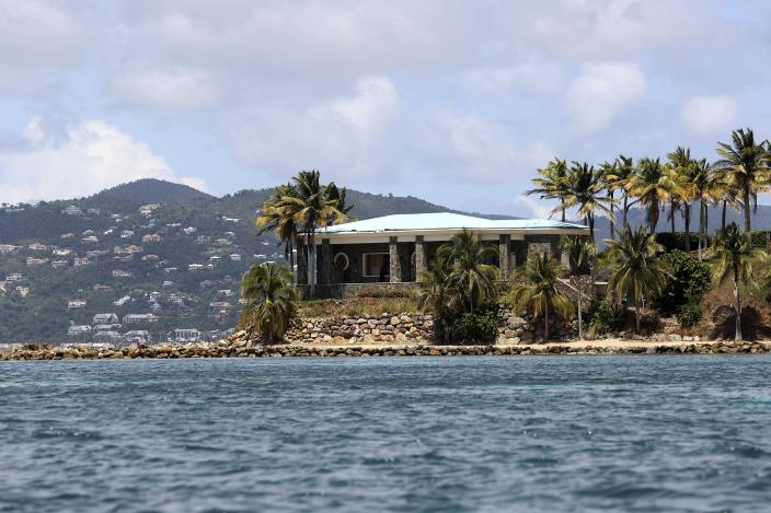 A view of Jeffrey Epstein's stone mansion on Little St. James Island, a property owned by Jeffrey Epstein, is backdropped by St. John Island, Wednesday, August 14, 2019. Federal authorities consider Little St. James Island to have been Epstein's primary residence in the United States, a place where at least one alleged victim said in a court affidavit that she participated in an orgy as well as had sex with Epstein and other people. (AP Photo/Gabriel Lopez Albarran)