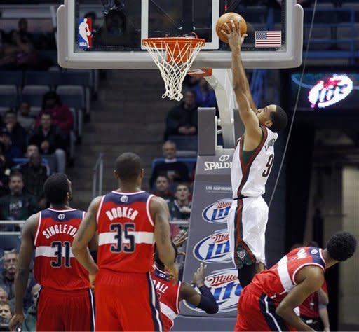 Milwaukee Bucks' Shaun Livingston (9) dunks in front of the Washington Wizards defenders during the first half of an NBA basketball game, Tuesday, Feb. 28, 2012, in Milwaukee. (AP Photo/Jeffrey Phelps)