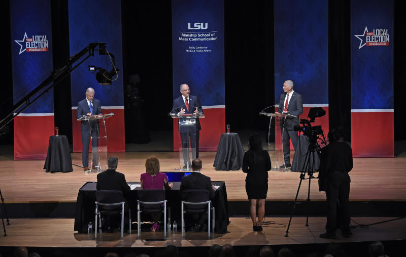 FILE - In this Sept. 19, 2019, file photo, from left, Eddie Rispone, Gov. John Bel Edwards and Republican Rep. Ralph Abraham participate in the first televised gubernatorial debate in Baton Rouge, La. Two main candidates are vying against Edwards on the ballot: Abraham, a third-term congressman and doctor from rural northeast Louisiana, and Rispone, a Baton Rouge businessman and longtime political donor who is largely self-financing his first bid for office.  (Bill Feig/The Advocate via AP, Pool, File)