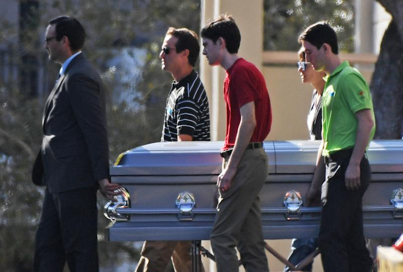 Pallbearers walk the casket of Scott Beigel, a teacher at Marjory Stoneman Douglas High School, following a service at Temple Beth El in Boca Raton, Fla., on Sunday. (Sun Sentinel via Getty Images)