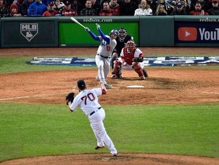 Oct 23, 2018; Boston, MA, USA; Los Angeles Dodgers first baseman Max Muncy (13) hits a single off of a pitch by Boston Red Sox relief pitcher Ryan Brasier (70) in the seventh inning in game one of the 2018 World Series at Fenway Park. Mandatory Credit: David Butler II-USA TODAY Sports