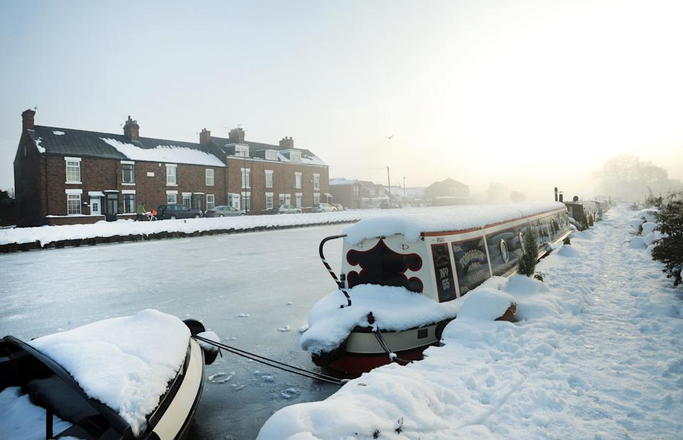 Canal boats frozen in their moorings as the Stainforth and Keadby Canal in Thorne, Doncaster. (PA)