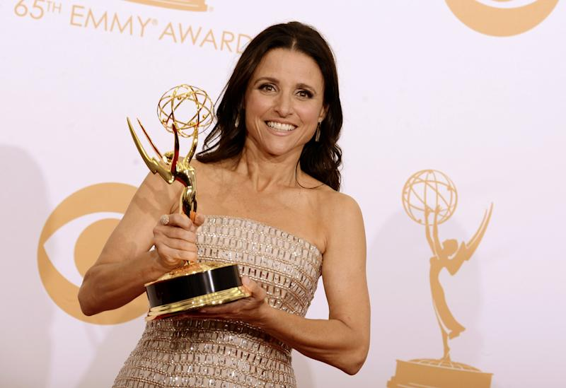 "FILE - This Sept. 22, 2013 file photo shows actress Julia Louis-Dreyfus backstage with the award for outstanding supporting actor in a comedy series for her role on ""Veep"" at the 65th Primetime Emmy Awards in Los Angeles. The Television Academy's Hall of Fame Selection Committee announced, Monday, Dec. 16, 2013, that Louis-Dreyfus will be inducted into the 23rd Hall of Fame. (Photo by Dan Steinberg/Invision/AP, File)"