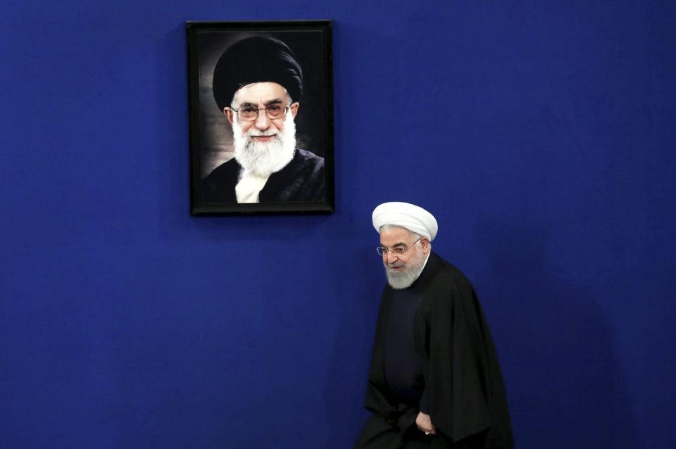 "<span class=""caption"">Iran's President Hassan Rouhani arrives for a news conference in Tehran, Iran, in February 2020, with a portrait of the Supreme Leader Ayatollah Ali Khamenei hanging on the wall behind him. Both men have signalled an interest in a new nuclear deal. </span> <span class=""attribution""><span class=""source"">(AP Photo/Ebrahim Noroozi)</span></span>"