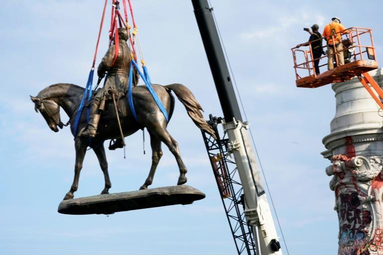 The statue of Confederate General Robert E. Lee after being removed from its pedestal in Richmond, Virginia (AFP/POOL)