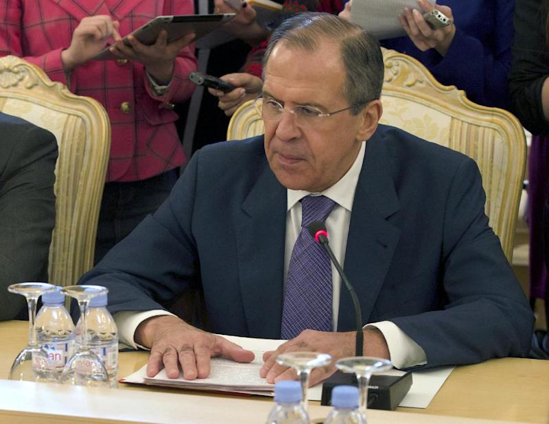 FILE- Russian Foreign Minister Sergey Lavrov, lays his hands on the table during talks with Thailand's Foreign Minister, not pictured, in Moscow, Russia, in this file photo dated  Thursday, March 28, 2013.  Lavrov on Friday April 5, 2013, is demanding an explanation for the North Korean warning that it can't guarantee the safety of embassies in its capital of Pyongyang in the event of a conflict, asking whether the warning is an order to evacuate their embassy or merely a suggestion that they should consider doing so. North Korea's government did not comment on the request for clarification.  (AP Photo/Ivan Sekretarev, File)