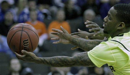 Baylor guard Pierre Jackson (55) chases a loose ball during the first half of an NCAA college basketball game against Kansas State in the Big 12 Conference tournament, Thursday, March 8, 2012, in Kansas City, Mo. (AP Photo/Charlie Riedel)