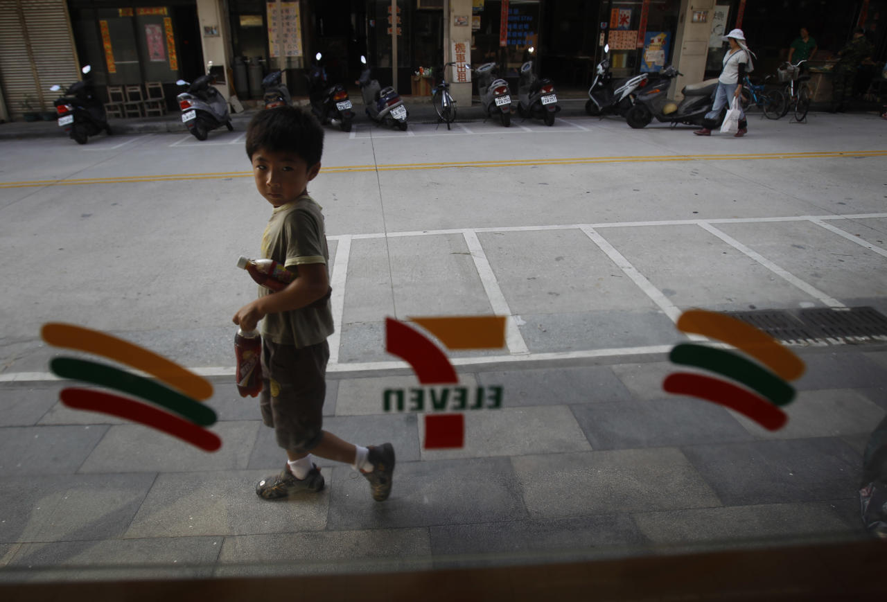 In this Aug. 22, 2012 photo, a young boy passes one of the only convenience shops on Beigan in the Matsu Island group off northern Taiwan. In early July some 3,000 Matsu residents voted 57 to 43 to permit casino gambling. Their votes were clearly influenced by the promises of not only a casino, but also a tourist resort, expanded airport, roadway infrastructure, a university, and perhaps most alluring of all, a monthly payment of 80,000 New Taiwan dollars ($2,666) for every resident. (AP Photo/Wally Santana)