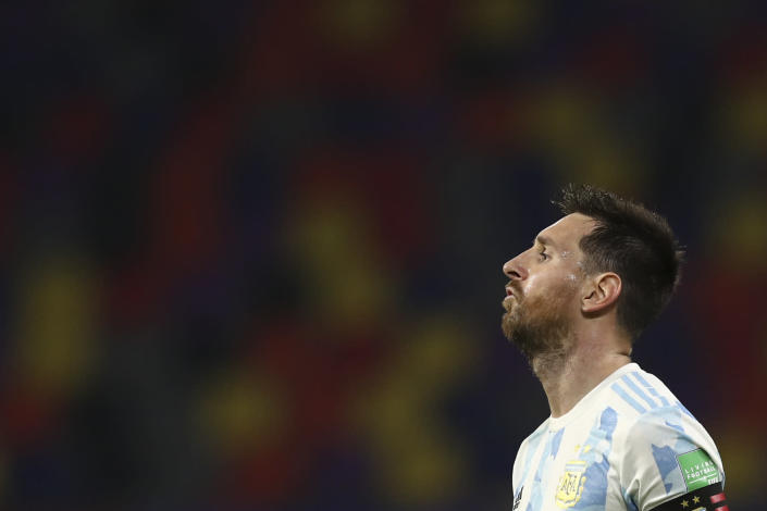 Argentina's Lionel Messi gestures during a qualifying soccer match against Chile for the FIFA World Cup Qatar 2022 in Santiago del Estero, Argentina, Thursday, June 3, 2021. (Agustin Marcarian, Pool via AP)