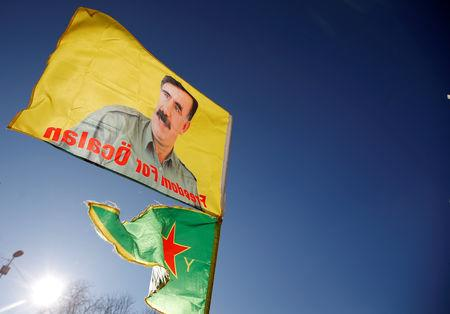 FILE PHOTO: Pro-Kurd protesters hold flags with portraits of jailed Kurdistan Workers Party (PKK) leader Abdullah Ocalan as they take part in a demonstration in support to him in Strasbourg, France, February 16, 2019. REUTERS/Vincent Kessler