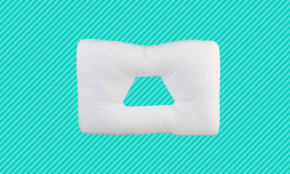 This pillow cradles your head while you sleep. (Photo: Amazon)