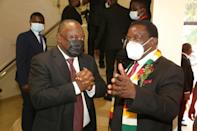 South African President Cyril Ramaphosa, left, speaks with Zimbabwean President Emmerson Mnangagwa during the memorial service