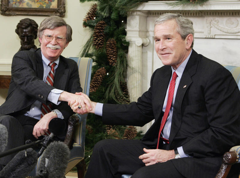 President George W. Bush (R) shakes hands with the U.S. Permanent Representative to the United Nations John Bolton after announcing to the press he is accepting Bolton's resignation from his position at the UN while in the Oval Office of the White House in Washington, December 4, 2006. (Photo: Larry Downing/Reuters)