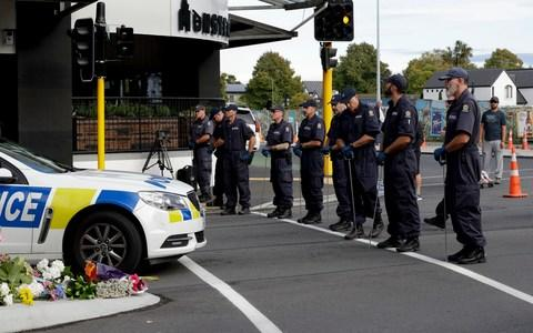 Police officers prepare to search the area near the Masjid Al Noor mosque, site of one of the mass shootings at two mosques in Christchurch - Credit: Mark Baker/AP