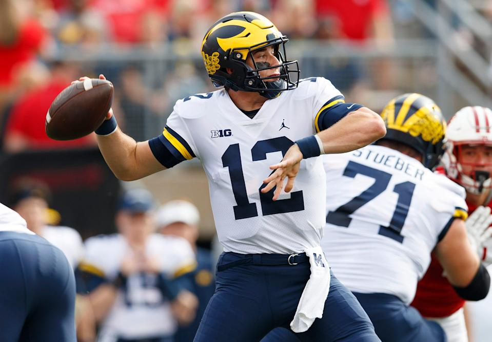 Michigan Wolverines quarterback Cade McNamara (12) throws a pass during the first quarter Oct. 2, 2021 against the Wisconsin Badgers at Camp Randall Stadium.