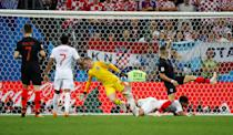<p>Ivan Perisic puts the ball past goalkeeper Jordan Pickford to level the scores at 1-1 </p>