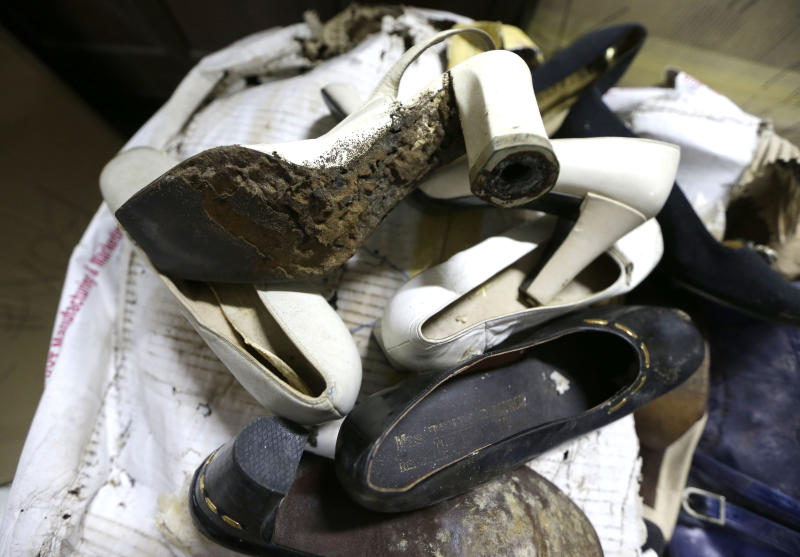 In this photo taken Sept. 19, 2012, a branded high heel shoe, once worn by flamboyant former Philippine first lady Imelda Marcos, sits among equally-damaged shoes in a section of the National Museum in Manila, Philippine. Termites, storms and government neglect have damaged some of Imelda Marcos's legendary stash of shoes, expensive gowns and other vanity possessions, which were left to oblivion after she and her dictator husband were driven to U.S. exile by a 1986 popular revolt. (AP Photo/Bullit Marquez)