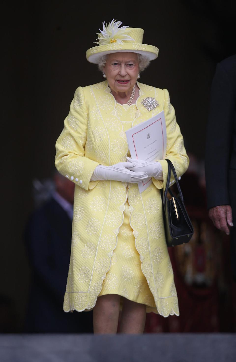 <p>The queen looked cheery in a lemon yellow dress, coat, and hat combo, with an eye-catching brooch and her traditional white gloves. <i>(Photo: PA Images)</i><br></p>