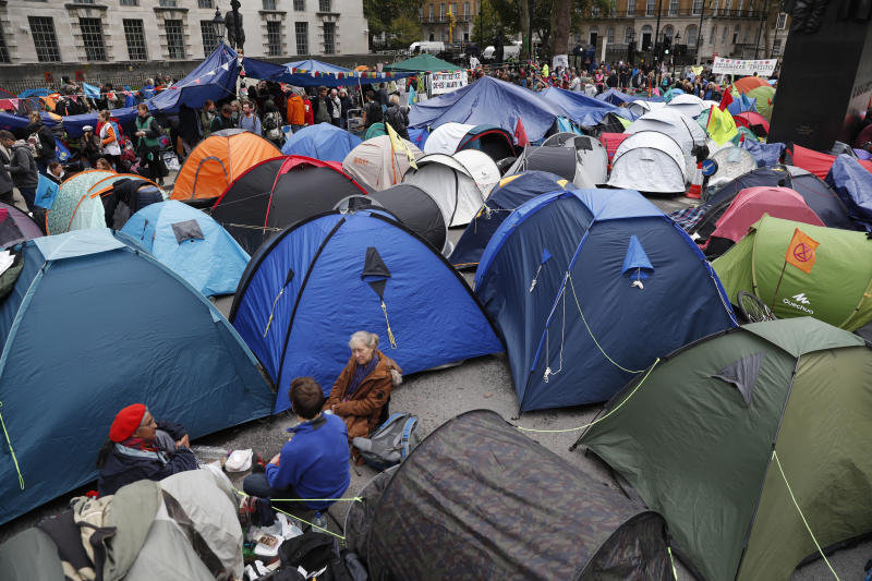 A general view of the pop up tents used by climate change protesters on Whitehall in London, Tuesday, Oct. 8, 2019.Police are reporting they have arrested more than 300 people at the start of two weeks of protests as the Extinction Rebellion group attempts to draw attention to global warming .(AP Photo/Alastair Grant)