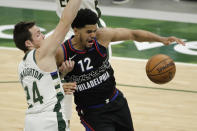 Philadelphia 76ers' Tobias Harris (12) loses control of the ball while being defended by Milwaukee Bucks' Pat Connaughton during the second half of an NBA basketball game Thursday, April 22, 2021, in Milwaukee. (AP Photo/Aaron Gash)