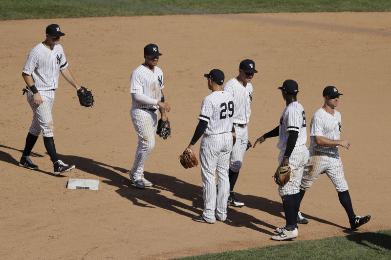 New York Yankees' Gio Urshela (29) and Didi Gregorius (18) celebrate with teammates after a baseball game against the Colorado Rockies Saturday, July 20, 2019, in New York. The Yankees won 11-5. (AP Photo/Frank Franklin II)