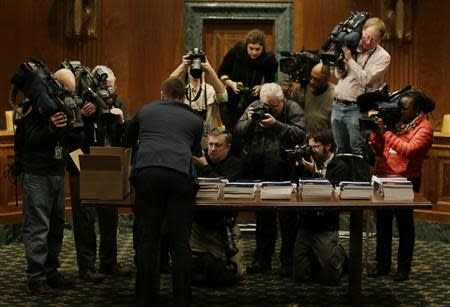 U.S. President Barack Obama's fiscal year 2015 budget proposal is captured by the media after being delivered to the Senate Budget Committee on Capitol Hill in Washington March 4, 2014. REUTERS/Gary Cameron