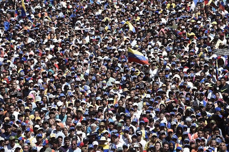 Supporters of Venezuelan opposition leader and self-declared acting president Juan Guaido take part in a rally to press the military to let in US humanitarian aid, in eastern Caracas on February 12, 2019 (AFP Photo/Federico PARRA)