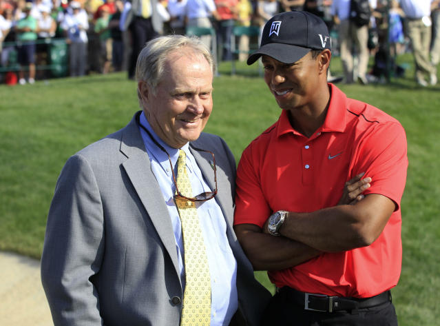 FILe - In this June 3, 2012 file photo, Jack Nicklaus, left, talks with Tiger Woods after Woods won the Memorial golf tournament at the Muirfield Village Golf Club in Dublin, Ohio. Nicklaus was in his customary spot behind the 18th green at Muirfield Village, waiting on the winner _ or in this case, the survivor. Given the meltdowns by top players, this year without Tiger Woods has shown that it's really hard to win or that Woods was really good at it. (AP Photo/Tony Dejak, File)