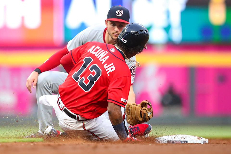 ATLANTA, GA - JULY 19: Ronald Acuna Jr. #13 of the Atlanta Braves is tagged out while attempting to steal second base by Trea Turner #7 of the Washington Nationals in the third inning during a game at SunTrust Park on July 19, 2019 in Atlanta, Georgia. (Photo by Carmen Mandato/Getty Images)