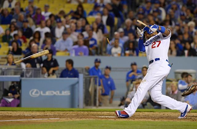 Los Angeles Dodgers' Matt Kemp breaks his bat as he flies out during the fourth inning of a baseball game against the Colorado Rockies, Friday, Sept. 27, 2013, in Los Angeles. (AP Photo/Mark J. Terrill)