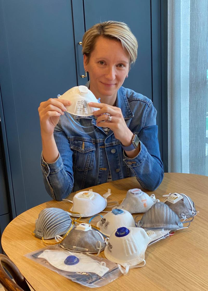 Kate Cole, who is also an occupational hygienist in Sydney, poses with a series of approved P2 respirators.