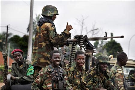 Seleka soldiers sit in a pick-up truck in Bangui, Central African Republic, December 6, 2013. REUTERS/Emmanuel Braun