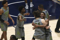 Baylor players celebrate an overtime win over West Virginia in an NCAA college basketball game Tuesday, March 2, 2021, in Morgantown, W.Va. (AP Photo/Kathleen Batten)