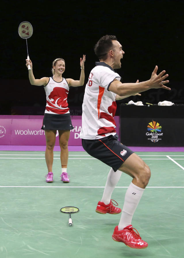 CORRECT NAMES OF PLAYERS - England's Chris Adcock, right, and Gabrielle Adcock celebrate after defeating their compatriots Marcus Ellis and Lauren Smith during their mixed doubles badminton final at Carrara Sports Hall during the Commonwealth Games on the Gold Coast, Australia, Sunday, April 15, 2018. (AP Photo/Dita Alangkara)