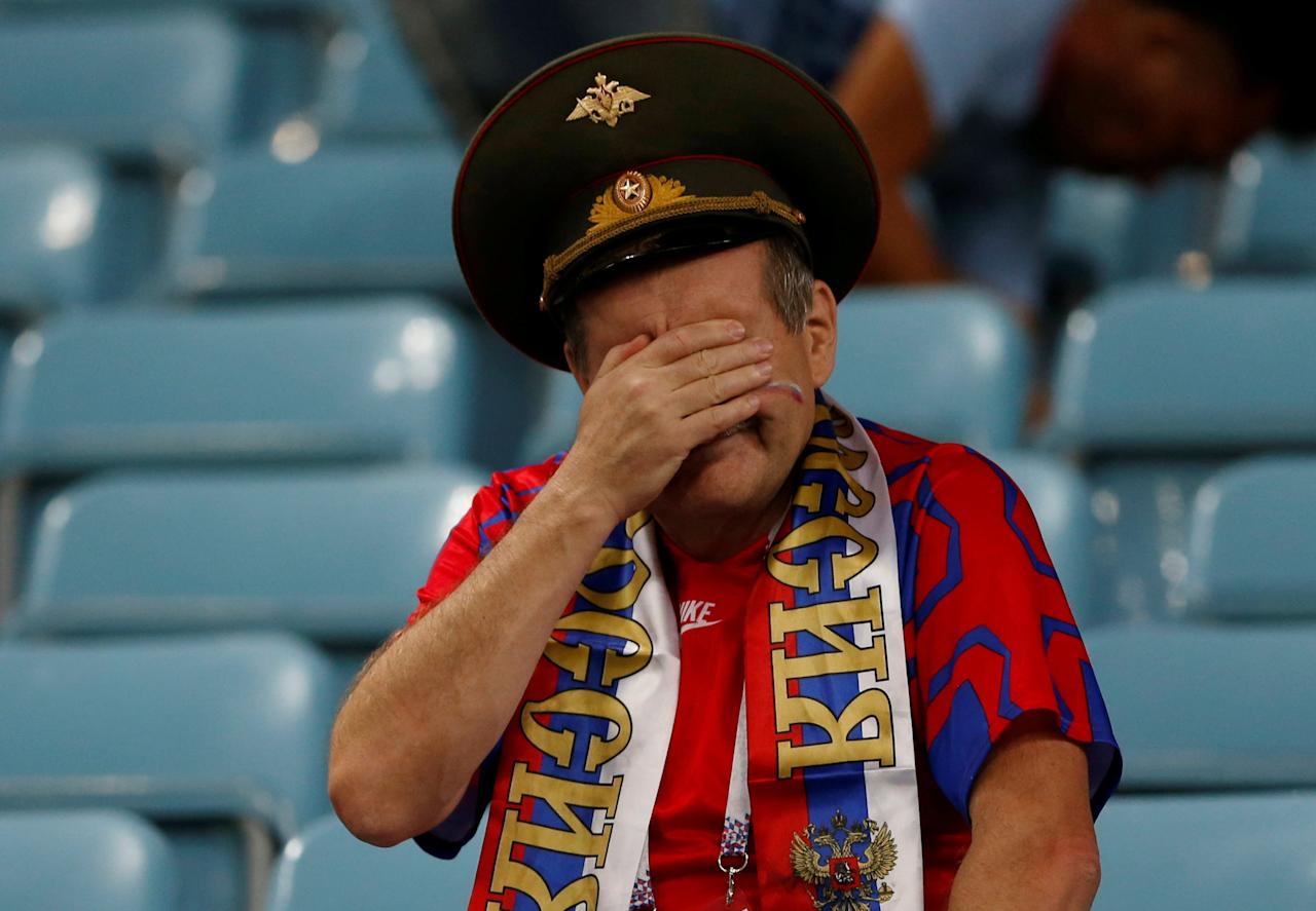 <p>A Russia fan cries after Russia's loss in the quarterfinal match between Russia and Croatia at the 2018 soccer World Cup in the Fisht Stadium, in Sochi, Russia, Saturday, July 7, 2018. (Reuters) </p>