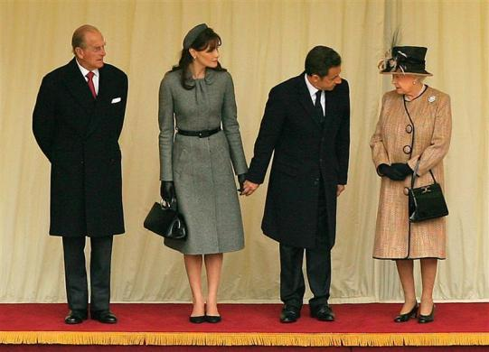 French president Nicolas Sarkozy (2nd R),and France's first lady Carla Bruni (2nd L), speak with Britain's Queen Elizabeth (R) as Prince Philip watches at Windsor Castle in Windsor, southern England March 26, 2008. French President Sarkozy arrived in London on a state visit he hopes will improve cooperation with Britain on illegal immigration, defense and the economy.