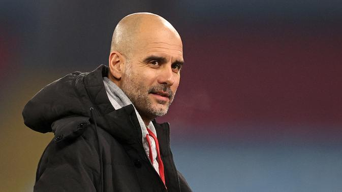 Manajer Manchester City, Pep Guardiola. (CARL RECINE / POOL / AFP)
