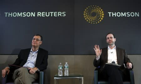 Reuters Editor-in-Chief Adler answers question with Deputy Editor-in-Chief Ingrassia during a meeting with staff members in New York