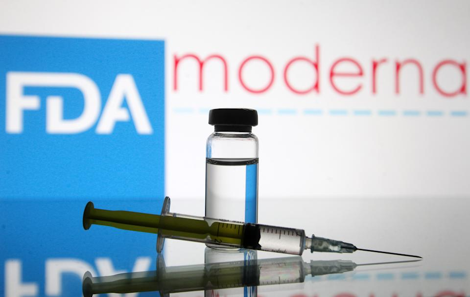 UKRAINE - 2020/12/15: In this photo illustration, a vial and a medical syringe seen displayed in front of the Food and Drug Administration (FDA) of the United States and Moderna biotechnology company's logos. FDA finds the COVID-19 vaccine. (Photo Illustration by Pavlo Gonchar/SOPA Images/LightRocket via Getty Images)