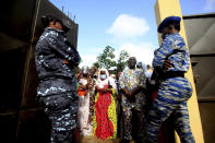 People wait in line to vote in presidential election in Abidjan, Ivory Coast, Saturday, Oct. 31, 2020. Tens of thousands of security forces deployed across Ivory Coast on Saturday as the leading opposition parties boycotted the election, calling President Alassane Ouattara's bid for a third term illegal. (AP Photo/Diomande Ble Blonde)