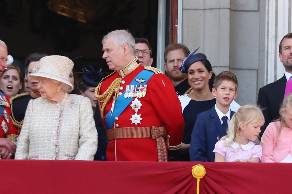 Harry and Meghan were barely visible tucked behind other royal faces. Photo: Getty Images