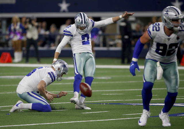 Dallas Cowboys' Chris Jones, left, holds and Jason Witten (82) blocks as kicker Brett Maher (2) kicks a 63 yard field goal in the first half of an NFL football game against the Philadelphia Eagles in Arlington, Texas, Sunday, Oct. 20, 2019. (AP Photo/Ron Jenkins)